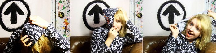 girl in hoodie posing with ATI logo on wall x 3