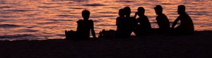 friends - silhouettes on shoreline
