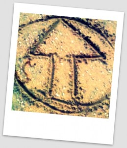 polaroid of ATI logo drawn in sand