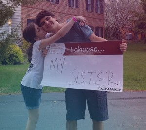 i choose my sister Ava. sister kissing and hugging brother