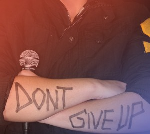 """Don't give up"" written on arms"