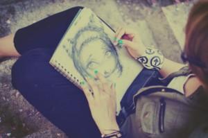 close up of girl sketching